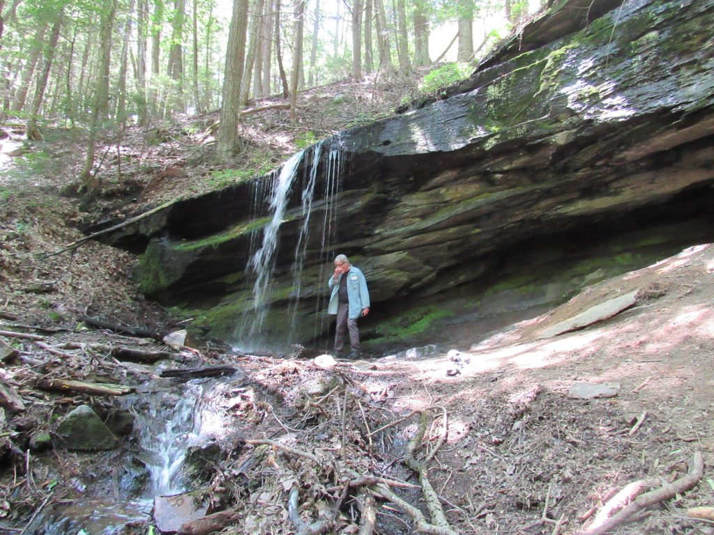 The poet takes the waters at the literary Lourdes of the Berkshires, Monument Mountain, Juky 2021; Mathew Lavalette photo.